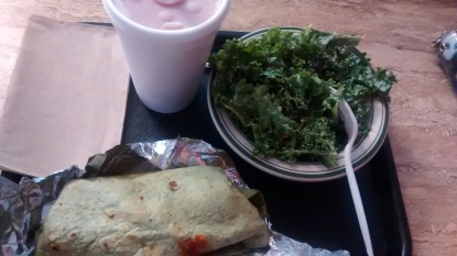Vegan burrito, garlic kale salad and tropical smoothie at Sunshine's Vegetarian Deli & Health Food Store